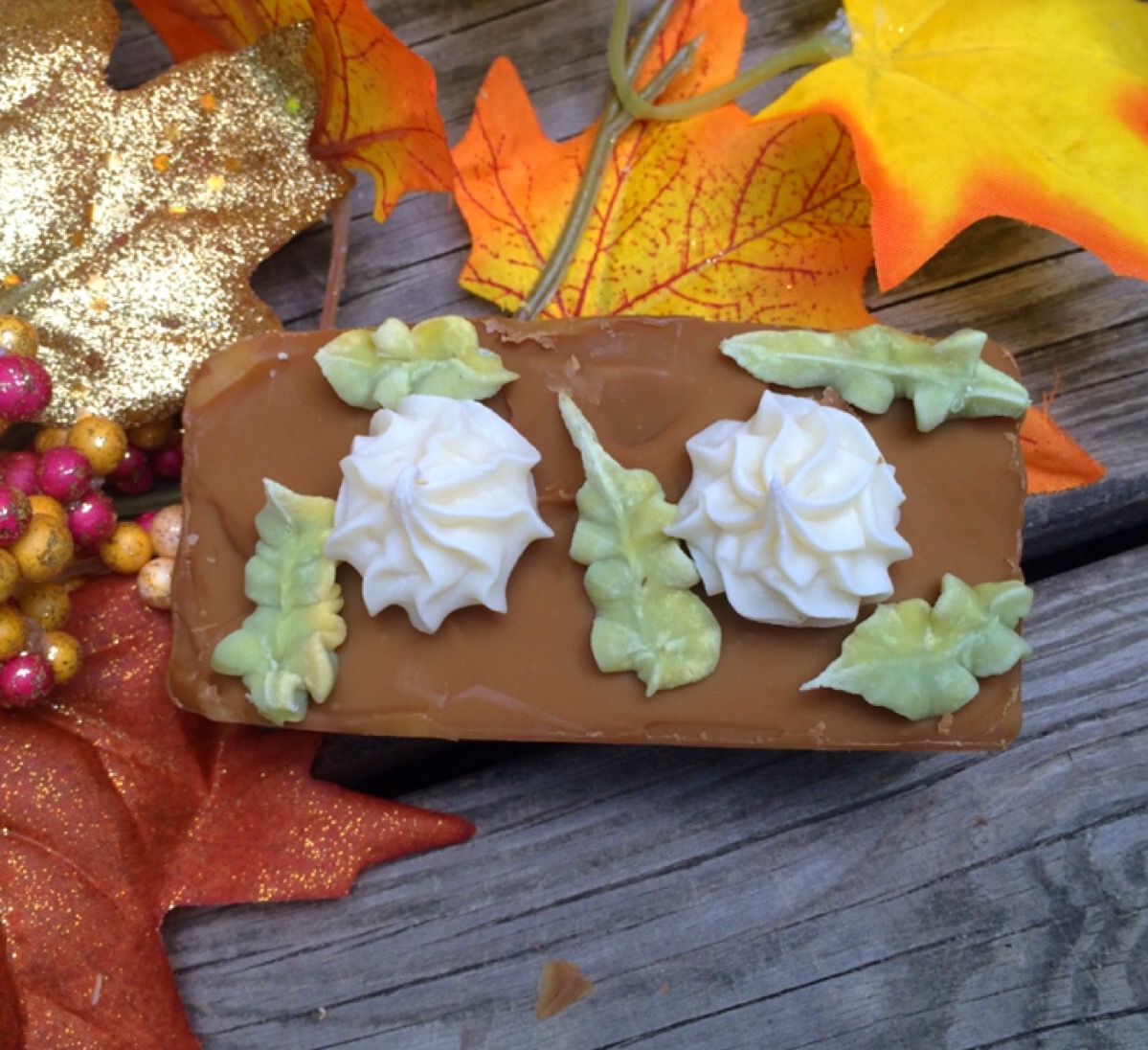 pumpkin bread soap with piped whip cream and piped green and yellow leaves