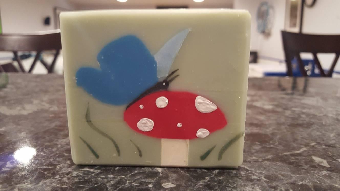 butterfly on top of mushroom soap