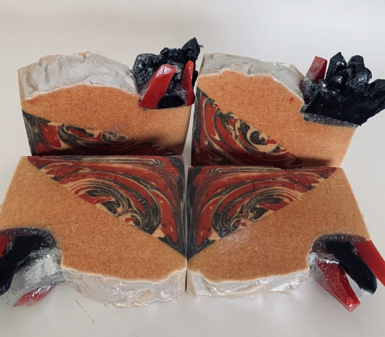 red and black geode soap